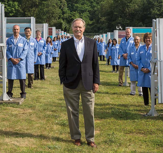 Benjamin Moore CEO Mike Searles stands with employees at our paint test farm.