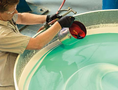 A Benjamin Moore employee mixes a vat of paint.