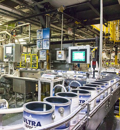 Cans of Benjamin Moore Ultra Spec 500 ride along the filling line.