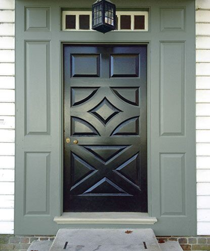 Color coordinated front entrance with dark green door and green side panels