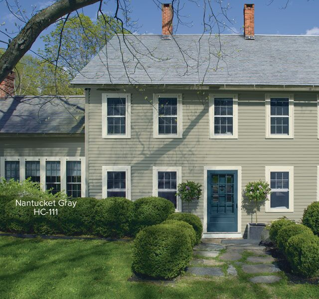 Colonial-style home with dark blue front door