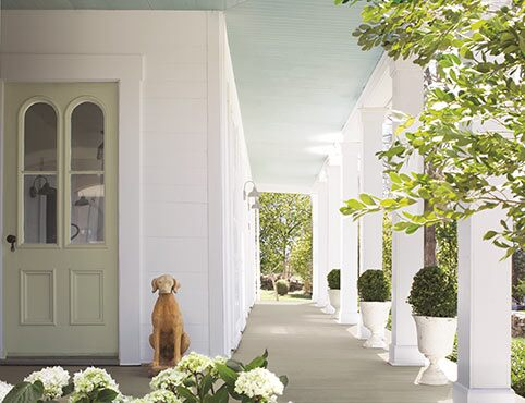 Open porch with columns and green landscape