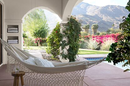 Scenic pool deck with Evening White OC-81 walls overlooking a mountain range.