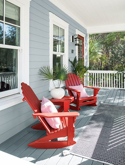 Front porch with wooden chairs painted in Caliente AF-290.