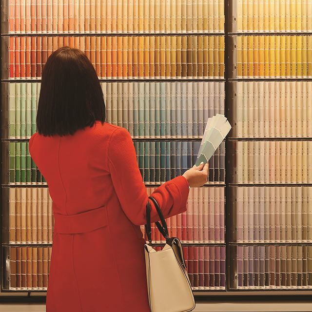 A customer shops for the right paint color at a Benjamin Moore store