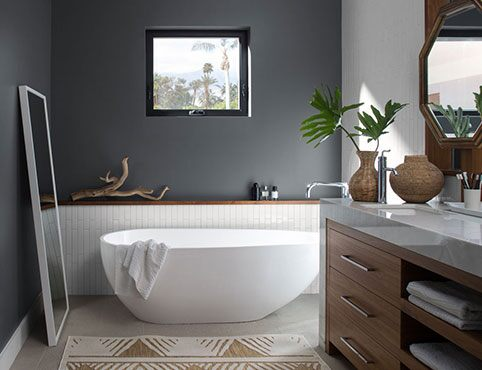 Bathroom walls painted in a matte gray charcoal slate paint color.