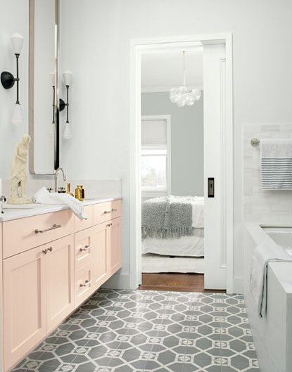 Soft, fresh bathroom with neutral painted walls and playful pink cabinets
