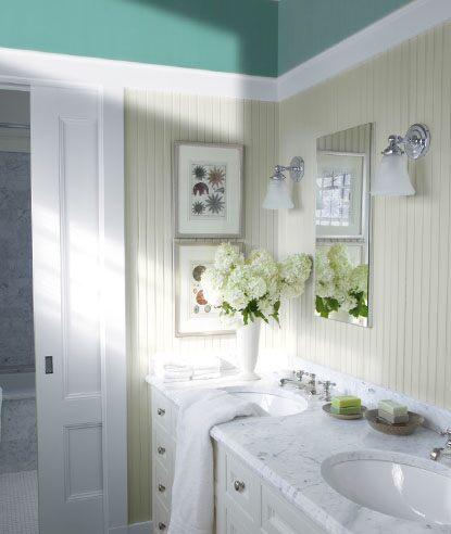 Master bathroom with marble double vanity, soft green walls and accents