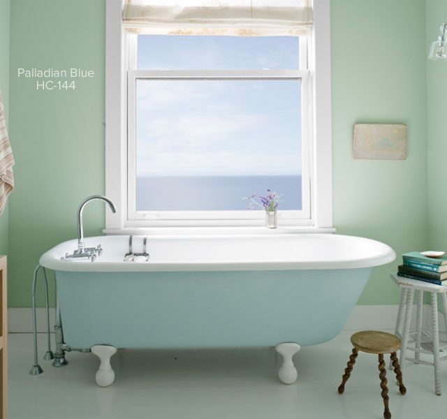 Serene light green bathroom with clawfoot tub