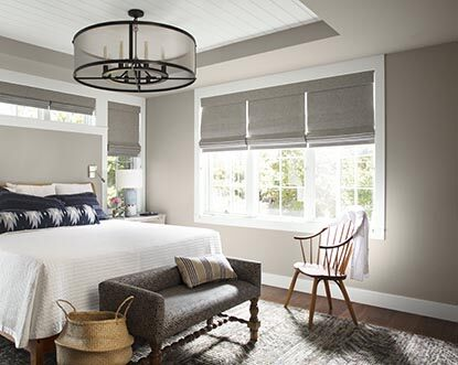 Naturally light gray bedroom with matching blinds.