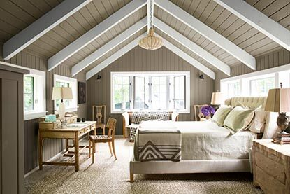 Rich craftsmen bedroom with an angled gray and white ceiling.