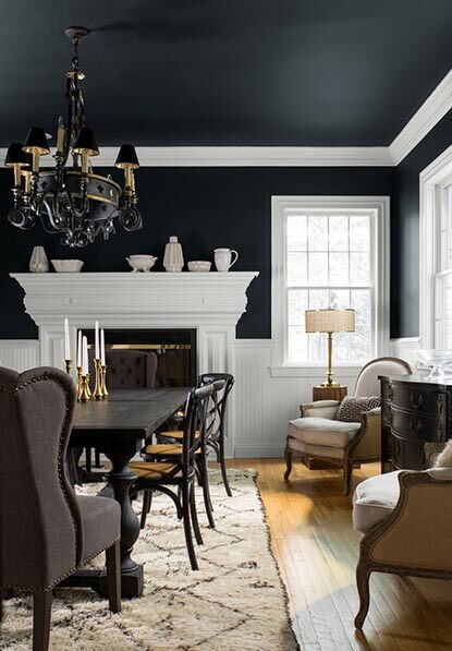 Large dining room with dramatic black walls and white trim.