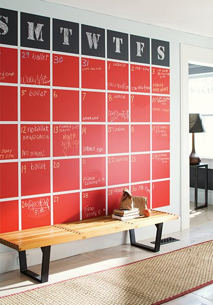 A bold chalkboard calendar keeps a busy family on schedule from this home's entryway.