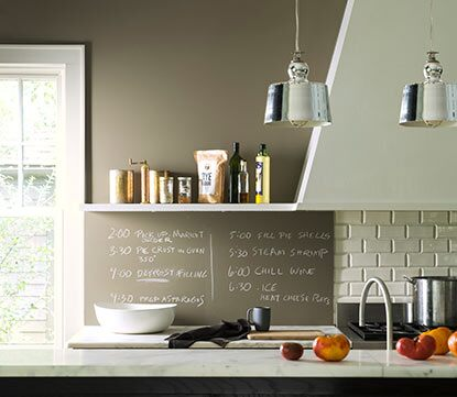 A gray kitchen chalkboard serves as a place to write recipes while cooking.