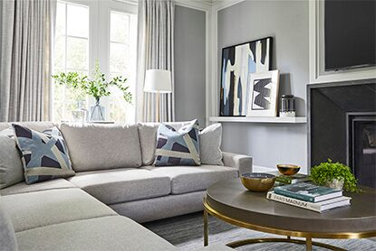 A neutral room with gray walls and a gray couch