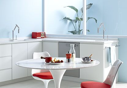 Stylish, modern kitchen and dining room combo with Kohler hardware
