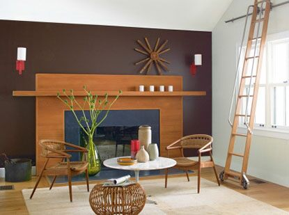 Living room with wide fireplace, purple wall and rolling ladder