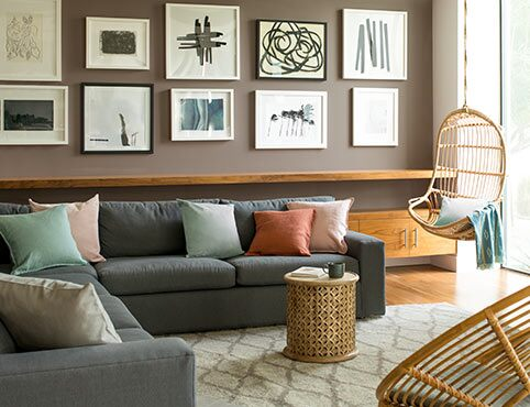A living room in neutral paint colors sets a relaxing, warm tone.