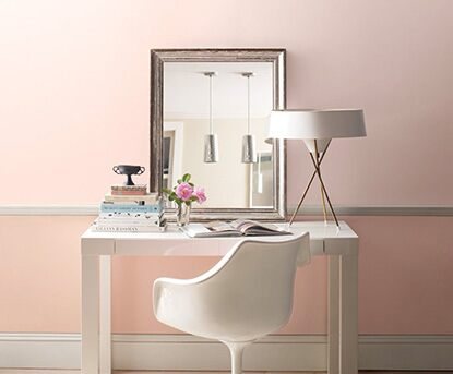 Home office painted in a light pale pink paint color