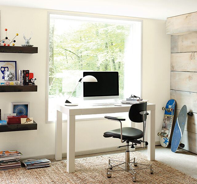 Home office painted in white with wood accent wall