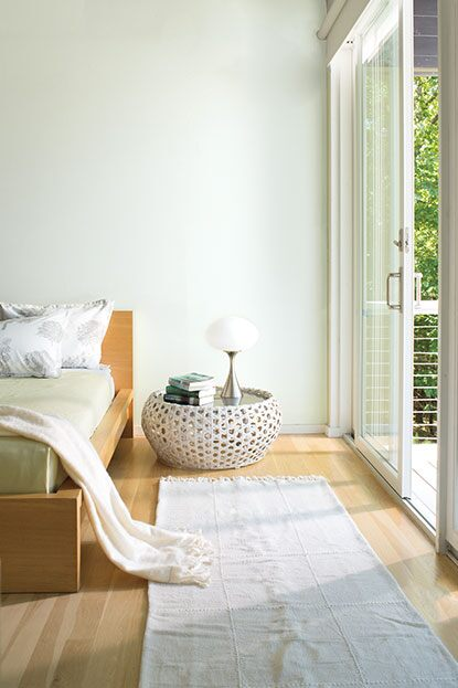 Minimal bedroom with walls painted in Palest Pistachio 2122-60.