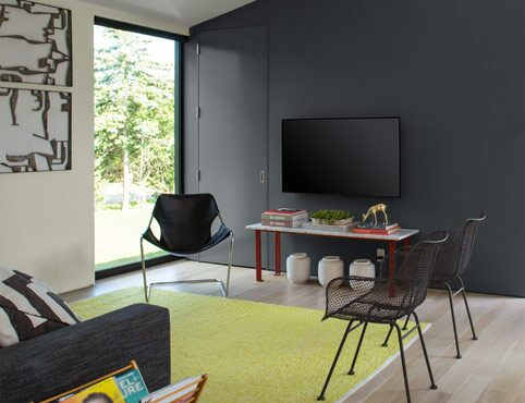 Gray painted accent wall with white walls in living room.