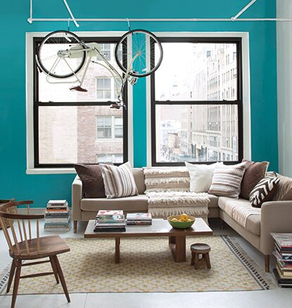 Apartment living room walls painted in the colour aqua