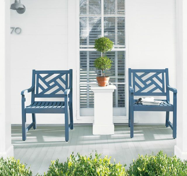 Gray arbor chairs on white deck with columns