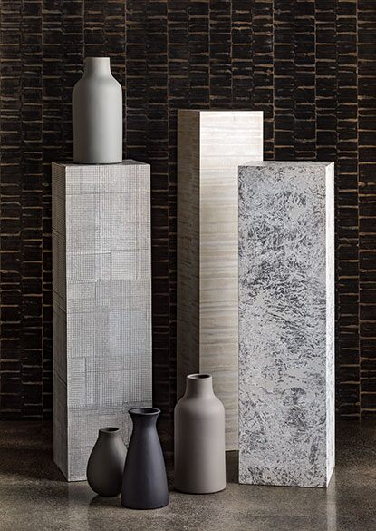 Curated textured artworks with ceramic pieces as accents in a neutral colour scheme