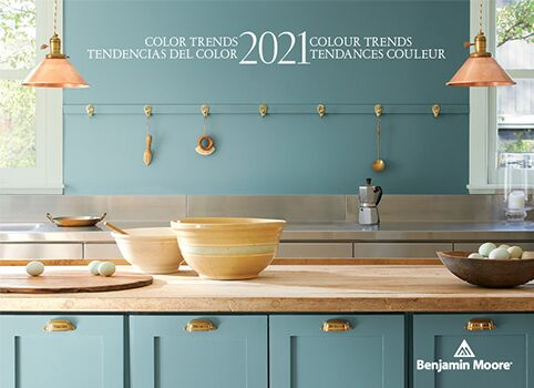 A kitchen with walls and cabinets painted with the Color of the Year 2021, Aegean Teal 2136-40.
