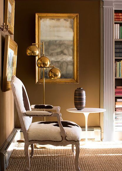 Warm, golden brown reading room with bookshelf