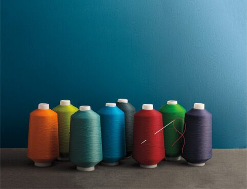 Multicoloured sewing spools reflect the accentuated response to light found in Aura Colour Stories.