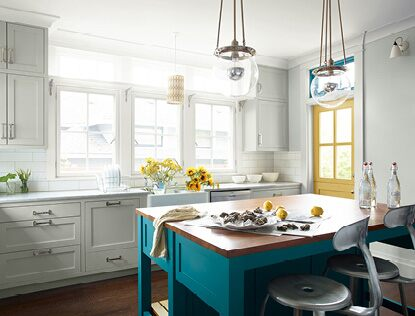 Bright, airy kitchen with a bold island painted in Caribbean Blue Water 2055-30.
