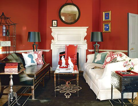Red living room with bold patterns and mixed styles