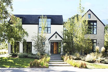 Modern country style home with white exterior and dark trim
