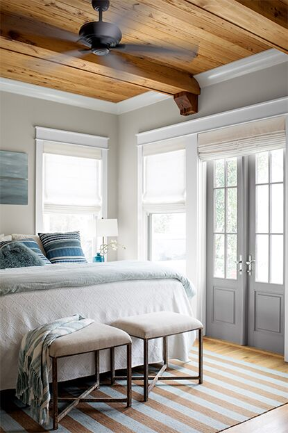 Bedroom with soft neutral color palettes and wood based ceiling
