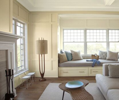 A cozy living room painted in pale yellow Man on the Moon OC-106 on walls.