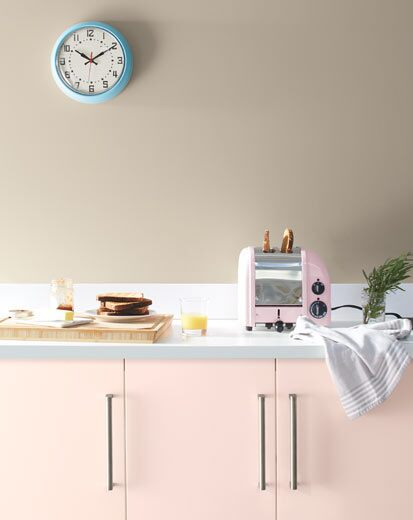 A pale kitchen with pink cabinets painted with Benjamin Moore's 2020 Color of the Year