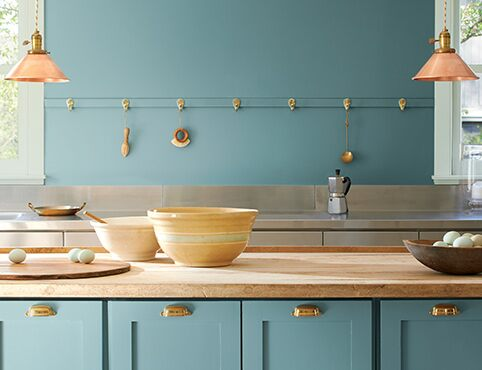 A kitchen with walls and cabinets painted with the Colour of the Year 2021, Aegean Teal 2136-40.