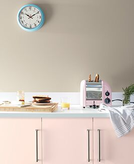 A pale kitchen with pink cabinets painted with Benjamin Moore's 2020 Color of the Year.