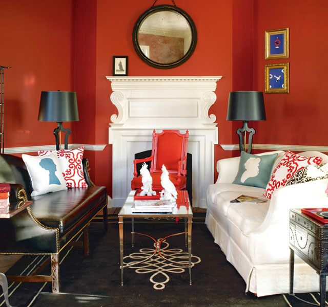 Red living room with bold patterns and a mix of styles