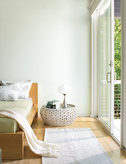 Crisp, light green bedroom retreat