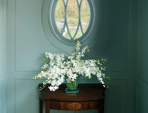 Hallway window with lillies and side table
