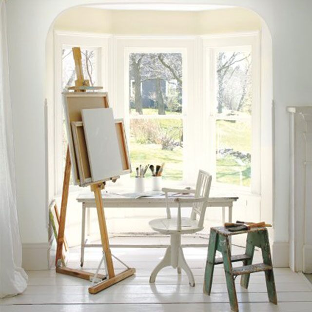 Sunny corner alcove with painting easel.