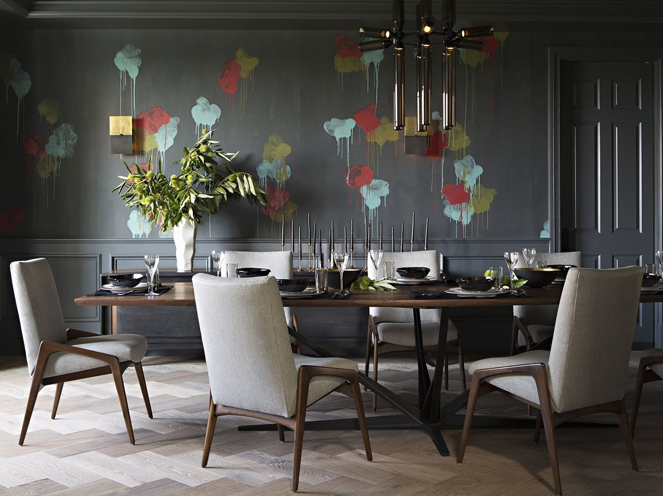 Modern dining room with colour-splashed gray walls, herringbone taupe rug and wood framed Danish style beige dining chairs.