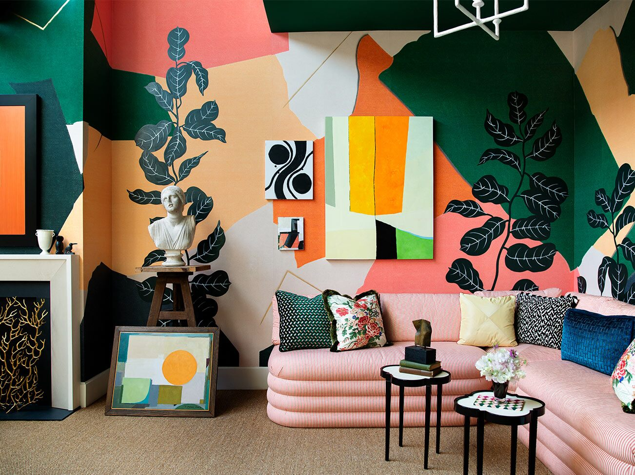 Young Huh's Kips Bay Decorator Show House 2019: Sitting room with pink couch and multi-colored abstract walls painted in a range of Benjamin Moore colors.