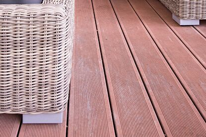Wood deck with wicker furniture