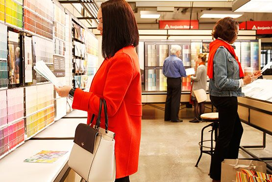 Customers shop in a Benjamin Moore store.