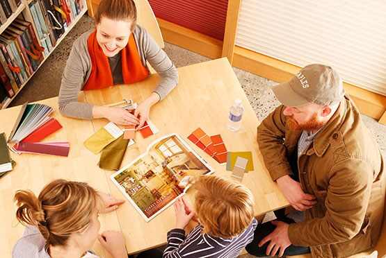 Customers discuss color options in a Benjamin Moore store