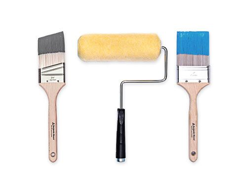 Two paint brushes and a paint roller.